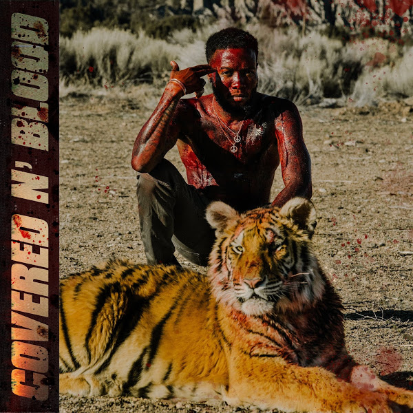 shy glizzy covered in blood